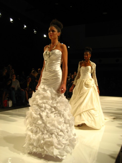 McCaffrey Haute Couture does make some beautiful wedding gowns. His cocktail dresses, which mix expertly the classic with the avant-garde, were also part of the show. www.mccaffreyhautecouture.com