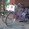 Keep an eye out for people on RightBike's signature purple bicycles.