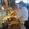 Dinner prep on-board the bus: Martina Gomez, chef in residence from Stadtlander's second restaurant Haisai and Eigensinn apprentice Falani Clifford