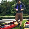 August 9, 2014 - Seeley's Bay, ON - Claude Galipeau zips his lifejacket before launching his kayak into the Little Cranberry Lake on the Rideau Canal Waterway. This was day 1 of 3 on our journey. On this day, we paddled over 14.5 km to Jones Falls.