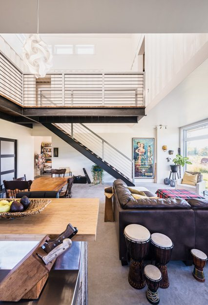 The living area is flooded with light from floor-to-ceiling windows. Photo by Christian Lalonde